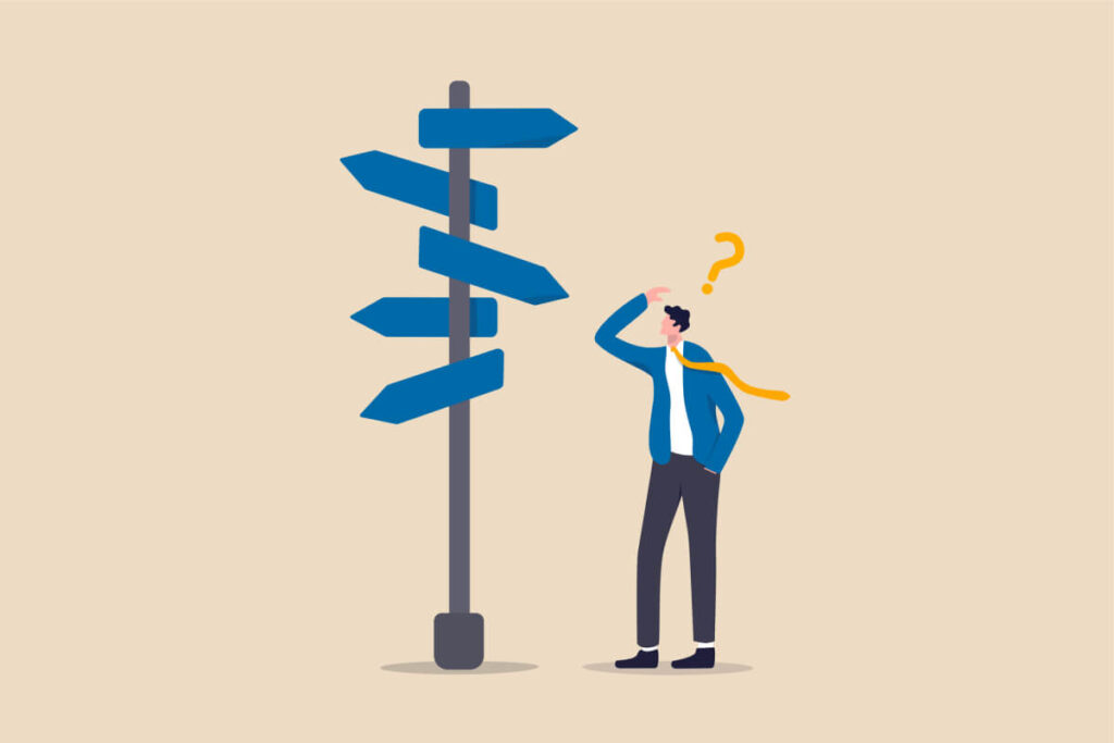 Confused businessman manager looking at multiple road signs and trying to determine which way to go